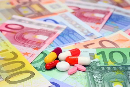 Assorted pills and capsules over euro money Stock Photo - 4383590