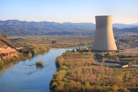 nuclear power plant: Asc� nuclear power plant over the Ebro river (Tarragona, Spain), warm afternoon light Editorial