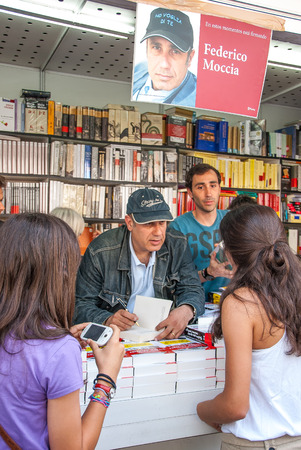 Federico Moccia signing books to some young readers at the book fair in Madrid in June 2011