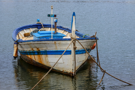 Old fishing boat of white and blue color