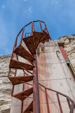Old and rusty spiral staircase Stock Photo