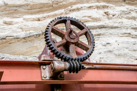 Rusty wheel in a construction