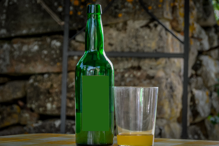 Cider bottle and glass with cider