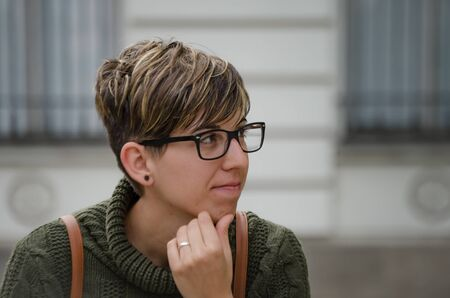 Young caucasion woman with short hair and glasses. Spain