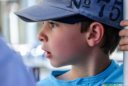Close-up of little boy in profile with blue cap Reklamní fotografie