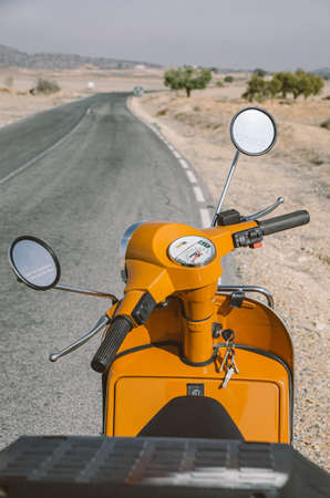 Road from an orange motorcycle Stockfoto