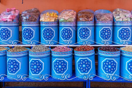 Blue containers decorated with stars of aromatic and sweet herbs. Morocco