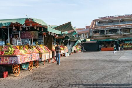 Fruit juice stalls in the Yamaa el Fna square in Marrakech. Morocco Stock Photo