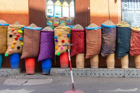 Colored sacks with spices for sale in a medina in Morocco Stock Photo