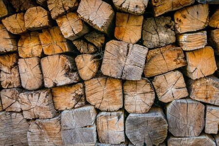 Close-up photograph of piled firewood background 版權商用圖片