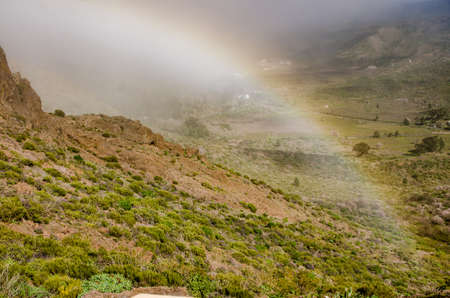 Rainbow in Masca in the municipality of Buenavista del Norte de Tenerife in the Canary Islands. Spain Stockfoto