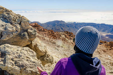 Girl with cap in El Teide National Park, Tenerife. Canary Islands. Spain. Stockfoto