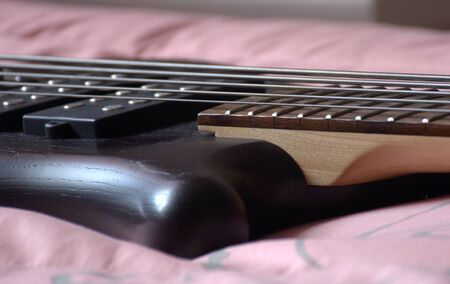5 Strings Bass Guitar Black Oil Color Stock Photo