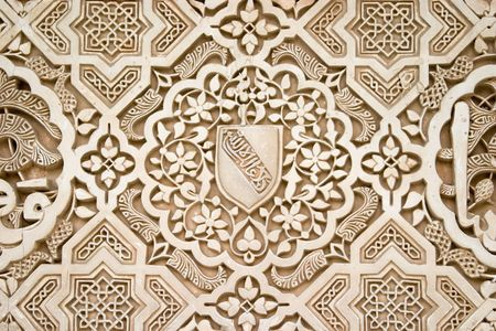 Detail of Islamic (Moorish) plasterwork and tilework at the Alhambra, Granada, Spain. 新闻类图片