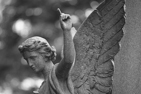 angel statue: Stone angel, pointing to heaven