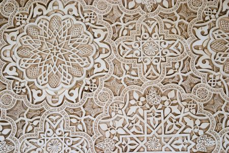 Detail of Islamic script on a wall at the Alhambra, Granada.