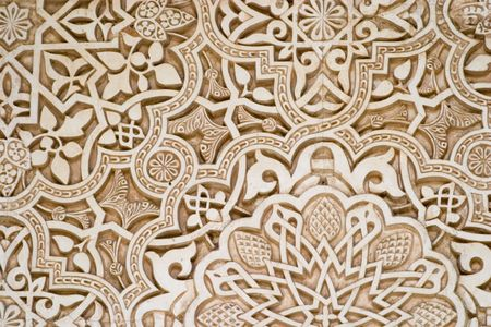 spanish tile: Detail of Islamic script on a wall at the Alhambra, Granada. Carving was done in plaster.