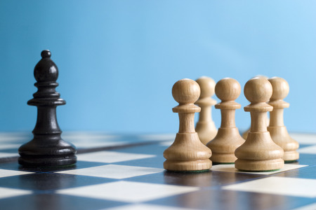 standoff: Teamwork, obstacle, pawns face down other chess piece