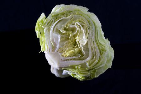 Iceberg lettuce on black