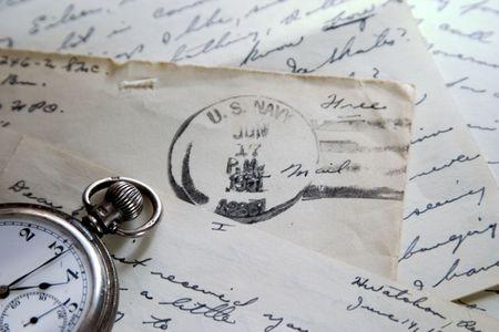 old envelope: Old pocket watch and love letter
