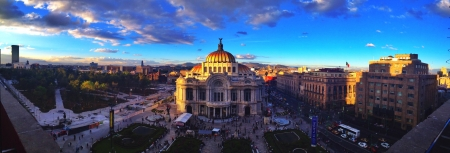 Panorama including Mexico Citys Fine Arts Palace and sorrounding Alameda Park  Bank of Mexico buildings at sunset.