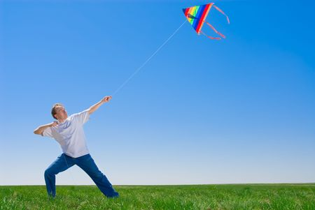 steadiness: Man tames a kite, can be used as a concept of steadiness, realiability and force in business