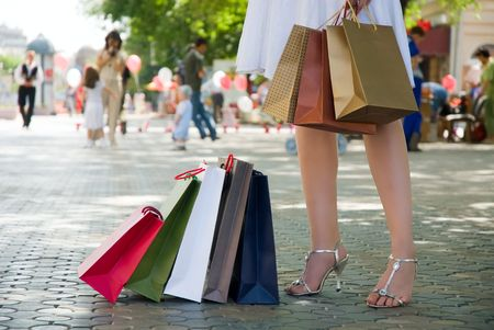 Woman with shopping bags at street photo
