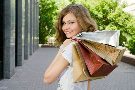 Very beautiful woman with shopping bags photo