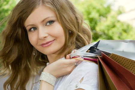 Close-up of beautiful woman with shopping bags photo