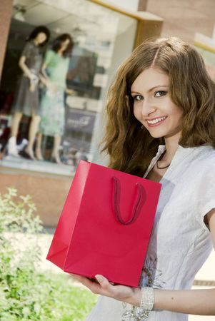 Smiling woman with shopping bag photo