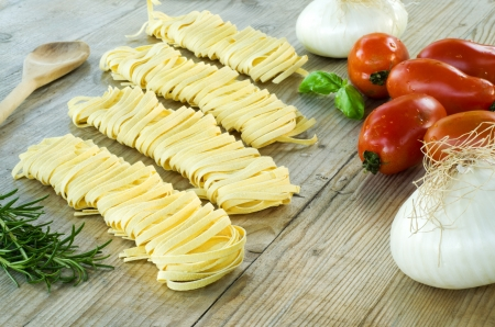 Homemade tagliatelle pasta and ingredients to cook Stock Photo - 14386392