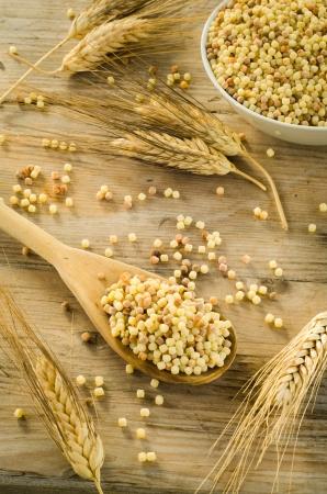 Fregola, typické sardinské tvrdé pšenice krupice Reklamní fotografie - 14419209