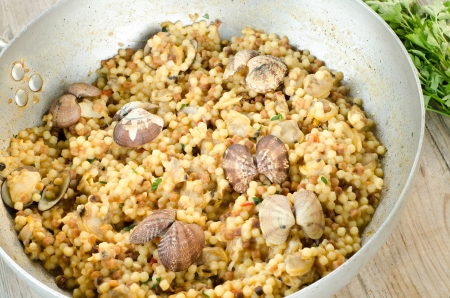 Cooked durum wheat semolina with clams, typical recipe from Sardinia photo
