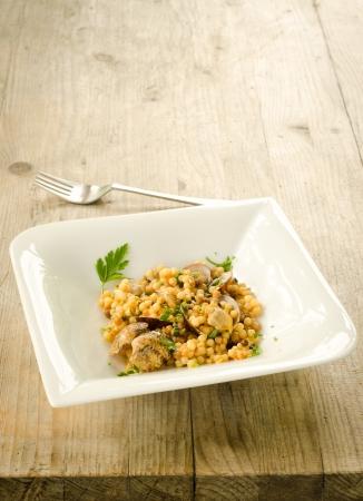 semolina pasta: Durum wheat semolina cooked with clams, typical pasta from Sardinia, Italy