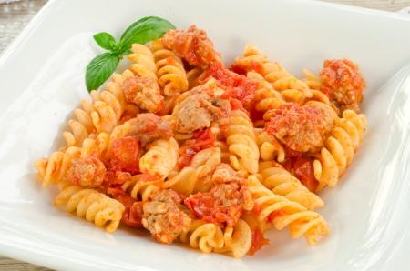 fusilli: Fusilli with tomato sauce and pork sausage