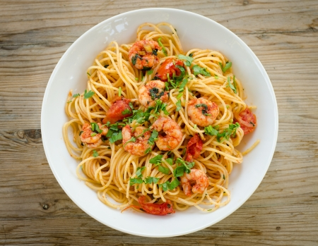 Spaghetti with shrimps,tomato sauce and parsley
