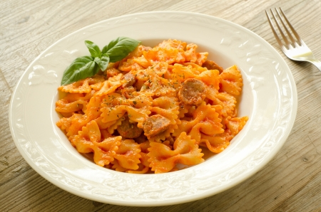 Farfalle topped with tomato sauce and meat Stock Photo - 15224371