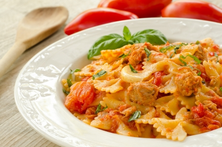 Farfalle topped with tomato sauce and tuna photo