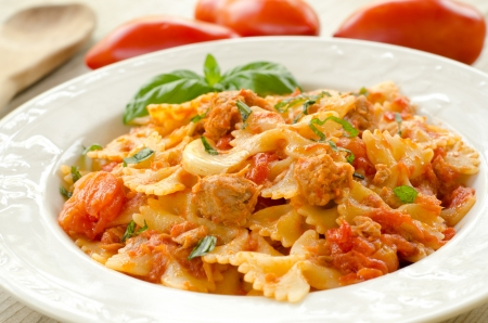 Farfalle topped with tomato sauce and tuna