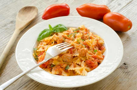 Farfalle topped with tomato sauce and tuna Stock Photo - 15255392