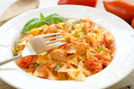topped: Farfalle topped with tomato sauce and tuna