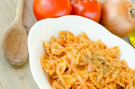 Farfalle pasta with tomato sauce and oregano Stock Photo - 15588957