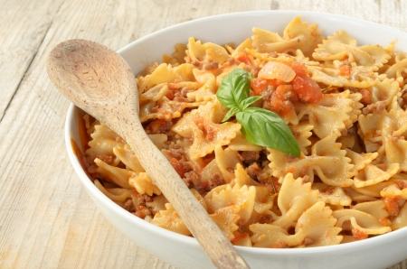 farfalle pasta topped with ragout sauce Stock Photo - 15610048