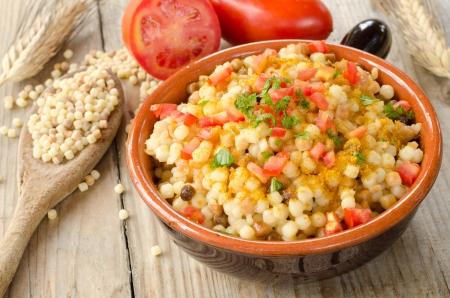 Fregola with bottarga, tomato and parsley - Sardinian Cuisine
