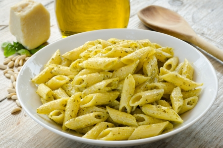 Mezze penne with pesto sauce photo