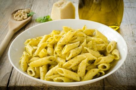 Mezze penne with pesto sauce Stock Photo