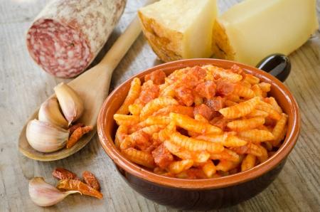 Malloreddus with tomato sauce and sausage, Sardinian Cuisine Stock Photo