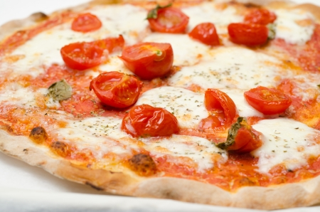 Pizza with fresh tomatoes Stock Photo