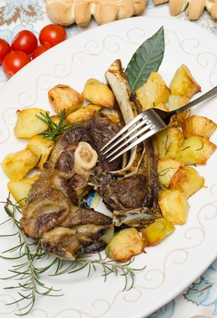 mutton: Roasted mutton with potatoes Stock Photo