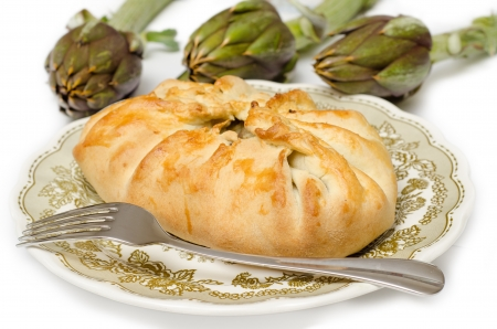 Savory pie stuffed with boiled artichokes